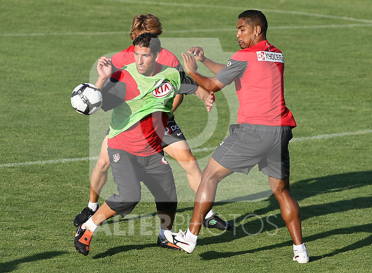 Atletico de Madrid's Raul Garcia (l) and Cleber Santana (r) during training sesion. August 05 2009. (ALTERPHOTOS/Acero).