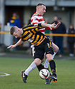 Alloa's Stephen Simmons and Hamilton's Darian MacKinnon challenge for the ball.