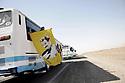Iraq 2009  .Supporters of PKK in a bus on the way to the Turkish border waving a flag with the portrait of Apo .Irak 2009 .Sympathisants du PKK dans un autobus en route pour la frontiere turque brandissant un drapeau avec le portrait d'Apo