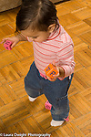 10 month old baby girl first steps walking holding toys in each hand