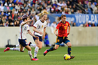 HARRISON, NJ - MARCH 08: Patri Guijarro #12 of Spain is chased by Megan Rapinoe #15 and Samantha Mewis #3 of the United States during a game between Spain and USWNT at Red Bull Arena on March 08, 2020 in Harrison, New Jersey.