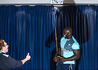 Adebayo Akinfenwa is unveiled as a new Wycombe player  & is approached by a supporter during the Wycombe Wanderers 2016/17 Kit launch to the Public at Adams Park, High Wycombe, England on 10 July 2016. Photo by Andy Rowland.