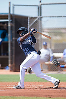 AZL Padres 1 shortstop Ruddy Giron (4) follows through on his swing during an Arizona League game against the AZL Royals at Peoria Sports Complex on July 4, 2018 in Peoria, Arizona. The AZL Royals defeated the AZL Padres 1 5-4. (Zachary Lucy/Four Seam Images)