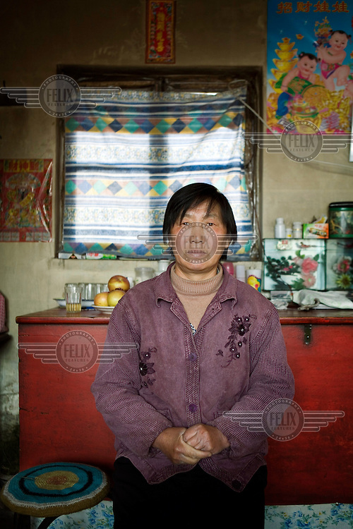 59-year-old Yang Shu Xia has been petitioning for an investigation into her son's conviction and death penalty sentence. Her son, Zhu Yan Qiang, has been in jail for over a decade waiting for his death sentence to be carried out following a confession that he made while under torture. Mrs. Yang believes that the court proceedings and evidence surrounding the case to be suspect.