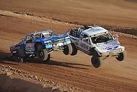 Dec. 11, 2011; Chandler, AZ, USA;  LOORRS pro 2 driver Robby Woods (99) and Carl Renezeder (17) during the Lucas Oil Challenge Cup at Firebird International Raceway. Mandatory Credit: Mark J. Rebilas-