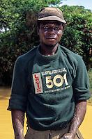 Tortiya, Ivory Coast (Cote d'Ivoire).  Artisanal Diamond Miner in Used San Francisco Shirt.