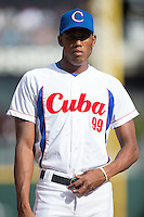 Yuniel Cano Vanes (99) of the Cuban National Team prior to the start of the game against the US Collegiate National Team at BB&T BallPark on July 4, 2015 in Charlotte, North Carolina.  The United State Collegiate National Team defeated the Cuban National Team 11-1.  (Brian Westerholt/Four Seam Images)
