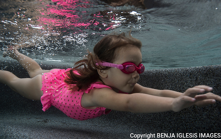 A 3 year old girl on her first adventure underwater.
