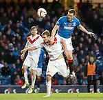 Jon Daly rises over Airdrie's captain Darren McCormack
