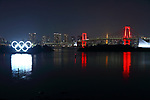 """The Rainbow Bridge is lit up in red, after the Tokyo Metropolitan Government has issued a """"Tokyo alert"""" due to an increase in coronavirus cases in Tokyo, Japan on June 2, 2020. (Photo by Naoki Nishimura/AFLO)"""