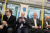 Tube passengers use smartphones.  London underground stations now have wi-fi.