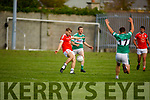 Adam Barry of Brosna about to shoot as Sean Lehane of  Listry is about to block his effort in the Junior Premier Football Championship quarter final.