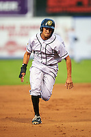 Jacksonville Suns outfielder Carlos Lopez (7) running the bases during a game against the Chattanooga Lookouts on April 30, 2015 at AT&T Field in Chattanooga, Tennessee.  Jacksonville defeated Chattanooga 6-4.  (Mike Janes/Four Seam Images)