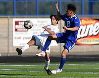 NWA Democrat-Gazette/CHARLIE KAIJO Rogers High School Maynor Sandoval (8) kicks during a soccer game, Friday, April 26, 2019 at  Whitey Smith Stadium at Rogers High School in Rogers.