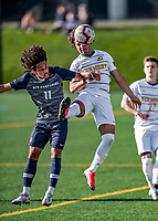 9 April 2021: University of Vermont Catamount Men's Soccer Forward JoJo Moulton-Condiotti, a Sophomore from Brooklyn, NY, keeps control away from University of New Hampshire Wildcat Midfielder Bilal Kamal, a Sophomore from London, England, in first-half action at Virtue Field in Burlington, Vermont. The Catamounts fell to the visiting Wildcats 2-1 for their first loss of the season in America East, Division 1 play. Mandatory Credit: Ed Wolfstein Photo *** RAW (NEF) Image File Available ***