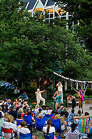 Cultural event photography of the 2012 Charlotte Shakespeare Festival, which took place on The Green in Uptown Charlotte from May 31 to June 17, 2012. Charlotte Shakespeare is a professional theatre company offering intimate performances of traditional and modern classics. The company was formed in 2005 by Elise Wilkinson and Joe Copley under the name Collaborative Arts Theatre. In 2012 the name changed to Charlotte Shakespeare. Photo shows actors performing The Tempest by William Shakespeare.