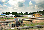 Pipe line worker on natural gas drilling site, Lycoming County, Pennsylvania...........................................