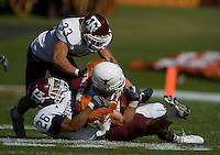 24 November 2006: Texas tight end Neale Tweedie (#87) is tackled by Aggie defenders Melvin Bullitt (#33) and Devin Gregg (#26) during the Longhorns game against the Texas A&M University Aggies at the Darrell K Royal Memorial Field in Austin, TX.