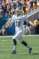Akron punter Zach Paul. The Akron Zips Defeated the Pitt Panthers 21-10 at Heinz Field, Pittsburgh. Pennsylvania on September 27, 2014.