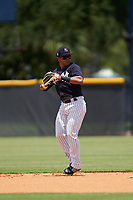 FCL Yankees second baseman Luis Santos (18) throws to first base during a game against the FCL Blue Jays on June 29, 2021 at the Yankees Minor League Complex in Tampa, Florida.  (Mike Janes/Four Seam Images)