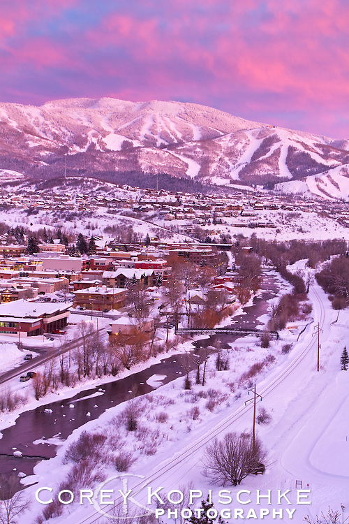 Winter alpenglow and downtown Steamboat Springs as seen from atop Howelsen Hill ski area.