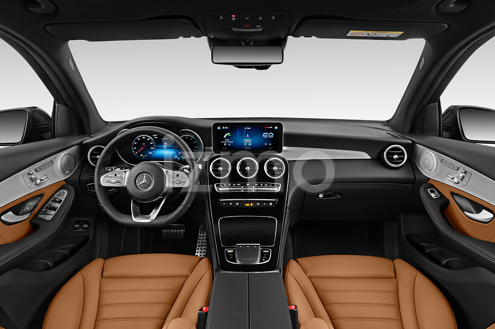 Stock photo of straight dashboard view of 2020 Mercedes Benz GLC AMG-Line 5 Door SUV Dashboard
