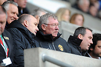 FAO SPORTS PICTURE DESK<br /> Pictured: Manchester United manager Sir Alex Ferguson (C) watching the game from the directors' box. Saturday, 28 April 2012<br /> Re: Premier League football, Swansea City FC v Wolverhampton Wanderers at the Liberty Stadium, south Wales.