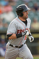 Fresno Grizzlies outfielder Travis Ishikawa (16) runs to first base during the Pacific Coast League baseball game against the Round Rock Express on June 22, 2014 at the Dell Diamond in Round Rock, Texas. The Express defeated the Grizzlies 2-1. (Andrew Woolley/Four Seam Images)