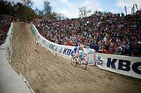"U23 European Champion Michael Vanthourenhout (BEL/Sunweb-Napoleon Games) proceeds U23 World Champion Wout Van Aert (BEL/Vastgoedservice-Golden Palace) going into ""The Pit""<br /> <br /> GP Zonhoven 2014"