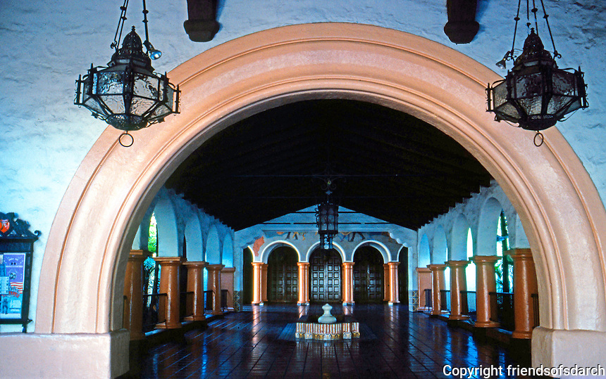 """Mission Revival: Fox Arlington Theater, Santa Barbara, 1929-1930. Arched entry to """"Paseo"""" from loggia.  Photo 1983."""