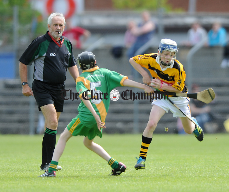 Michael Cotter of O Callaghan's Mills in action against Ian Murray Of Bodyke during their U-14C final at Cusack Park. Photograph by John Kelly.