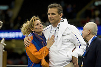 01 January 2010:  Florida head coach Urban Meyer hugs his wife on the trophy presentation platform after winning the game against Cincinnati during Sugar Bowl at the SuperDome in New Orleans, Louisiana.  Florida defeated Cincinnati, 51-24.