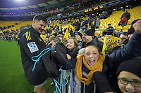 Kobus van Wyk gives his boots to fans after the Super Rugby Aotearoa match between the Hurricanes and Chiefs at Sky Stadium in Wellington, New Zealand on Saturday, 8 August 2020. Photo: Dave Lintott / lintottphoto.co.nz