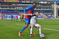 Harrison Reed of Fulham and Christian Benteke of Crystal Palace battle for the ball during the Premier League behind closed doors match between Crystal Palace and Fulham at Selhurst Park, London, England on 28 February 2021. Photo by Vince Mignott / PRiME Media Images.