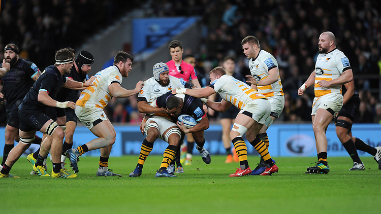 Kyle Sinckler of Harlequins tackled by Nizaam Carr of Wasps during Big Game 11, the Gallagher Premiership Rugby match between Harlequins and Wasps, at Twickenham Stadium on Saturday 29th December 2018 (Photo by Rob Munro/Stewart Communications)