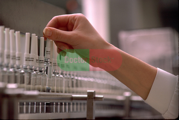 hand with laboratory vials