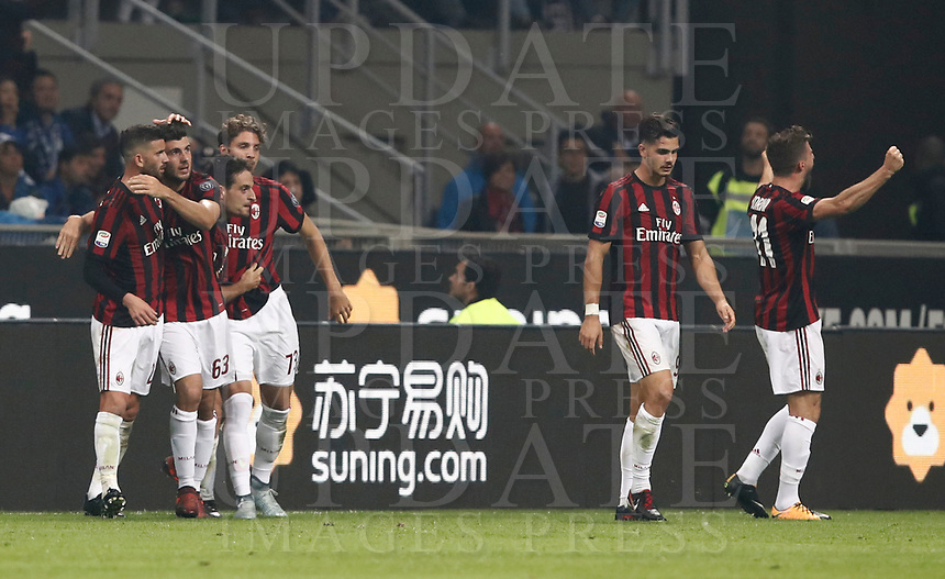 Calcio, Serie A: Milano, stadio Giuseppe Meazza, 15 ottobre 2017.<br /> Milan's Giacomo Bonaventura celebrates after scoring with his teammates during the Italian Serie A football match between Inter and Milan at Giuseppe Meazza (San Siro) stadium, October15, 2017.<br /> UPDATE IMAGES PRESS/Isabella Bonotto