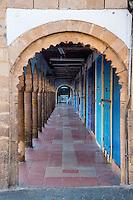 Essaouira, Morocco.  Early Morning Arcade of Shops along Avenue Mohamed Zerktouni in the Medina.