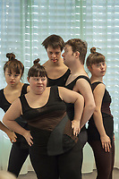"Switzerland. Canton Ticino. Gordola. Casa Riposo (Retirement Home) Solarium. MOPS_DanceSyndrome is an independent Swiss artistic, cultural and social organisation operating in the field of contemporary dance and disability. It is composed only of Down dancers. Five dancers( left to right): Elisabetta Montobbio (L), Amedea   Aloisi (LC), Vinzenz Häussermann (C), Simone Lunardi (RC) and Gaia Mereu (R) on stage during ""Choreus Numinis""  show. Down syndrome (DS or DNS), also known as trisomy 21, is a genetic disorder caused by the presence of all or part of a third copy of chromosome 21 It is usually associated with physical growth delays, mild to moderate intellectual disability, and characteristic facial features. A group of elderly people, all seated in wheelchairs, look at the woman dancing. A retirement home – sometimes called an old people's home or old age home - is a multi-residence housing facility intended for the elderly. Gordola is a municipality in the district of Locarno. 29.11.2019 © 2019 Didier Ruef"