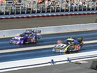 Feb 12, 2017; Pomona, CA, USA; NHRA funny car driver Matt Hagan (right) races alongside Jack Beckman during the Winternationals at Auto Club Raceway at Pomona. Mandatory Credit: Mark J. Rebilas-USA TODAY Sports