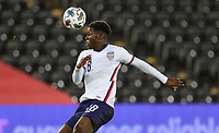 SWANSEA, WALES - NOVEMBER 12: Yunus Musah #18 of the United States turns and moves with the ball during a game between Wales and USMNT at Liberty Stadium on November 12, 2020 in Swansea, Wales.