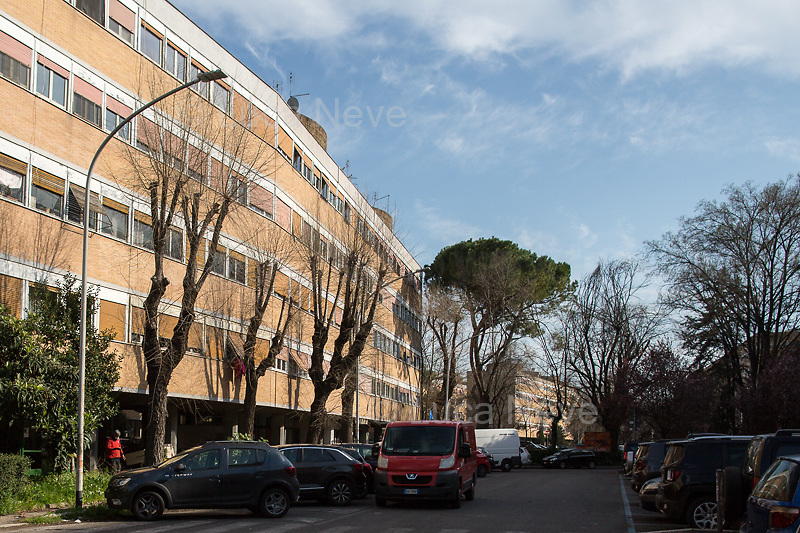 Delivery: allowed.<br /> <br /> Rome, 18/03/2020. Rome's Olympic Village district under the Italian Government lockdown for the Outbreak of the Coronavirus SARS-CoV-2 - COVID-19. On the 22nd March, the Italian PM Giuseppe Conte signed a new Decree Law which suspends non-essential industry productions and contains the list of allowed working activities, which includes Pharmaceutical & food Industry, oil & gas extraction, clothes & fabric, tobacco, transports, postal & banking services (timetables & number of agencies reduced), delivery, security, hotels, communication & info services, architecture & engineer, IT manufacturers & shops, call centers, domestic personnel (1.).<br /> Updates: Italy: 22.03.20, 6:00PM: 46.638 positive cases; 7.024 recovered; 5.476 died.<br /> <br /> The Rome's Olympic Village (1957-1960) was designed by: V. Cafiero, A. Libera, A. Luccichenti, V. Monaco, L. Moretti. «Built to host the approximately 8,000 athletes involved in the 1960 Olympic Games, Rome's Olympic Village is a residential complex located between Via Flaminia, the slopes of Villa Glori and Monti Parioli. It was converted into public housing [6500 inhabitants, ndr] at the end of the sporting event. The intervention is an example of organic settlement, characterized by a strong formal homogeneity, consistent with the Modern Movement's principles of urbanism. The different architectural structures are made uniform by the use of some common elements: the pilotis, ribbon windows, concrete stringcourses, and yellow brick curtain covering. At the center of the neighborhood, the Corso Francia viaduct - a road bridge about one kilometer long - was built by Pier Luigi Nervi […]» (2.).<br /> <br /> Info about COVID-19 in Italy: http://bit.do/fzRVu (ITA) - http://bit.do/fzRV5 (ENG)<br /> 1. March 22nd Decree Law http://bit.do/fFwJn (ITA)<br /> 2. (Atlantearchitetture.beniculturali.it MiBACT, ITA - ENG) http://bit.do/fFw3H<br /> 12.03.20 Rome's Lockdown for the Outbreak of the Coronavirus 