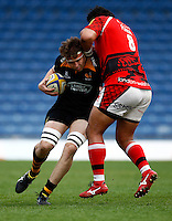 Photo: Richard Lane/Richard Lane Photography. London Welsh v Wasps. Aviva Premiership. 12/04/2015. Wasps' James Cannon is tackled by Welsh's Opeti Fonua.