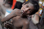 Boy begging in the Paharganj district of New Delhi, India.