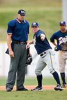 Charleston manager Torre Tyson (13) gets his monies worth as he argues with home plate umpire Tom Walkoviak at Fieldcrest Cannon Stadium in Kannapolis, NC, Wednesday, April 18, 2007.  The River Dogs defeated the Intimidators by the score of 1-0.