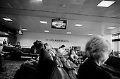 Phoenix, Arizona.USA.March 16, 2007..The fourth anniversary of the war in Iraq is marked by CNN broadcasting a weekly special which no one at this airport watches.