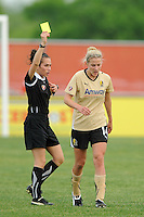 Referee Stephanie Toth issues a yellow card to Becky Edwards (14) of FC Gold Pride. FC Gold Pride defeated Sky Blue FC 1-0 during a Women's Professional Soccer (WPS) match at Yurcak Field in Piscataway, NJ, on May 1, 2010.