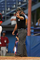 Umpire Donnie Smith signals to Mahoning Valley Scrappers manager Travis Fryman (not shown) before ejecting him during a game against the Batavia Muckdogs on June 24, 2015 at Dwyer Stadium in Batavia, New York.  Batavia defeated Mahoning Valley 1-0 as three Muckdogs pitchers combined to throw a perfect game.  (Mike Janes/Four Seam Images)
