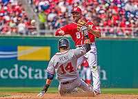 14 April 2013: Washington Nationals second baseman Danny Espinosa turns a double-play during game action against the Atlanta Braves at Nationals Park in Washington, DC. The Braves shut out the Nationals 9-0 to sweep their 3-game series. Mandatory Credit: Ed Wolfstein Photo *** RAW (NEF) Image File Available ***