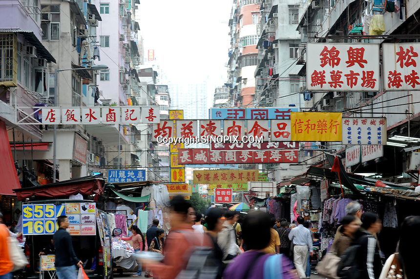 Street Market on Apliu Steet in Sham Shui Po district, Hong Kong. Apliu Street is famous for its electronics and accessories stalls. The vendors in this open-air street market sells a wide variety of products at reasonable prices, allowing individuals to trade second hand goods here..